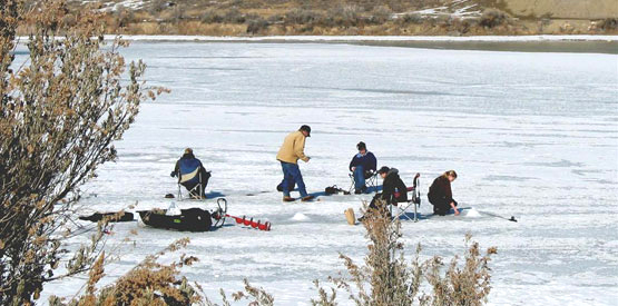 Group ice fishing on Mack Mesa Reservoir within Highline Lake State Park