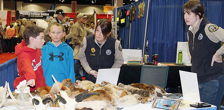 Youth learning about wildlife through pelts