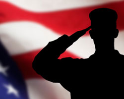 Sillouette of soldier saluting flag