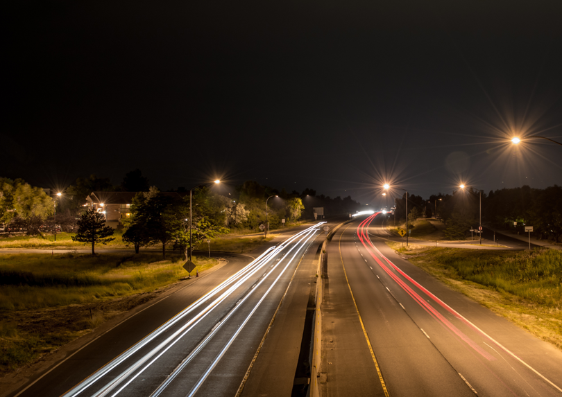 A road at night. Lights and roads are a form of human interference.