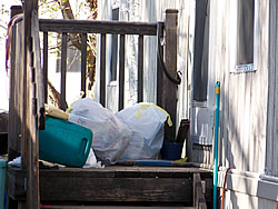 Trash bags stored outside—bears can't resist checking them out. Photo © CDOW/A. Ryel.