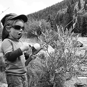 Child fishing in creek
