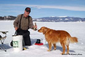 Granby Reservoir ice angler using sonar and a two-rod system to catch lake trout. Photo courtesy of Dennis McKinney.