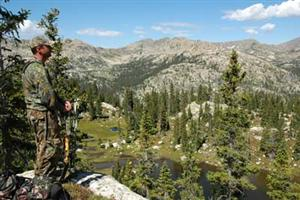 Bowhunter Overlooking Valley © T.Baskfield/CPW