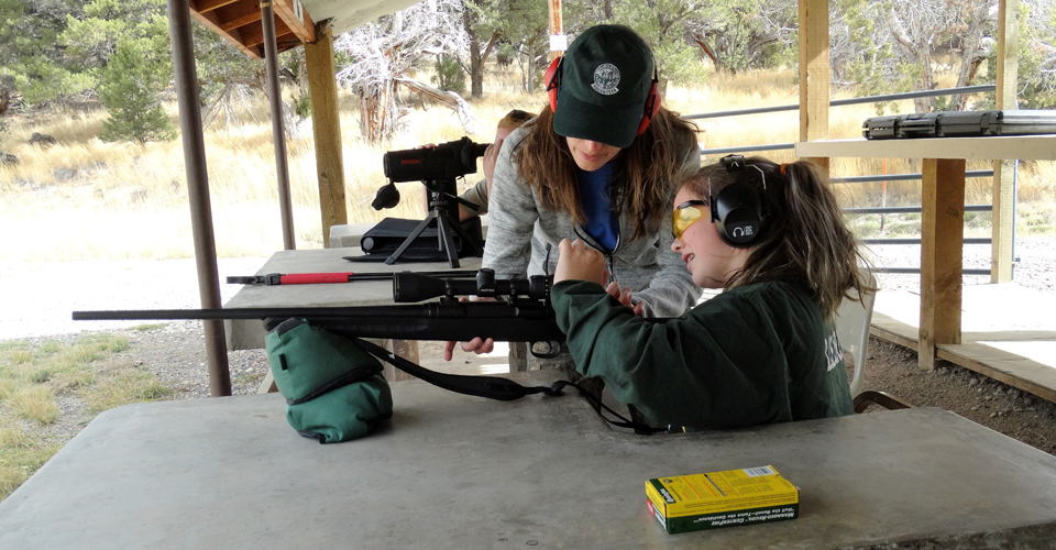 Hunting mentor with student at shooting range