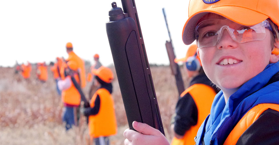 Novice Hunter Program - Boy smiling while pheasant hunting with class