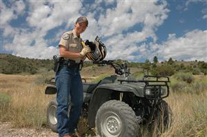 Female District Wildlife Manager on ATV patrol