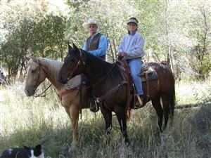 The winners of the Landowner of the Year, Lowell and LoAnn Klinglesmith, shown here on horseback.