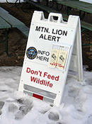 mountain lion alert sign