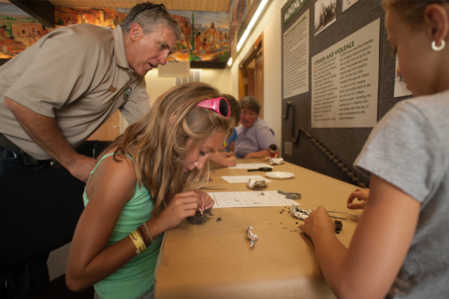Children learn about owl pellets during an educational event at Lathrop State Park.