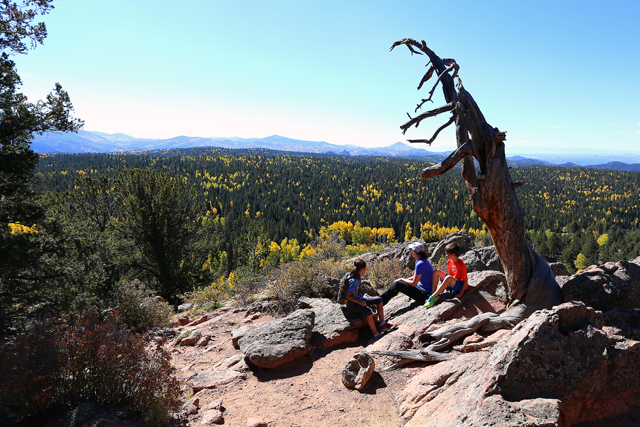 Hikers enjoy the fall colors at Mueller State Park.