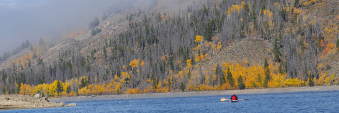 Kayaker in fall at Lake Granby