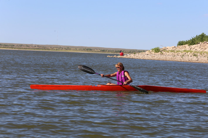 woman in long kayak
