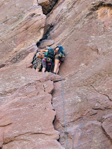 climbers grouped on a ledge