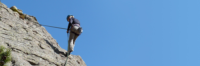Woman preparing to rappel.