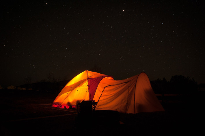 Navajo glowing tent with background of stars