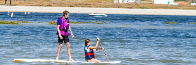 Kids paddle Boarding at Boyd Lake.