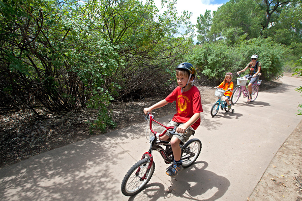 A family riding a paved trail at James M. Robb State Park. Photo by Ken Papaleo.
