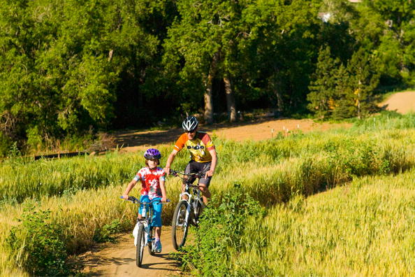 A family riding a trail at the Valmont Bike Park. Photo courtesy of the Valmont Bike Park.