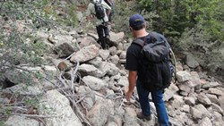 Two hikers on rocky trail - photo 5