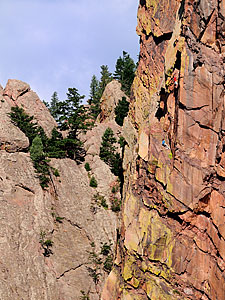 Two climbers on cliff-side of Eldorado Canyon State Park.