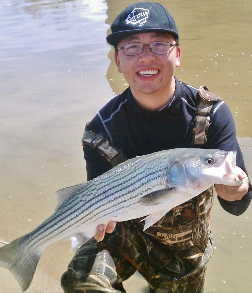 Angler with striper caught at Ser Her Spillway