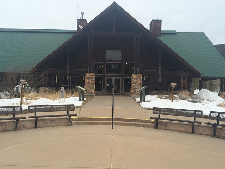 A photo of the front entrance of the State Forest Moose Visitor Center